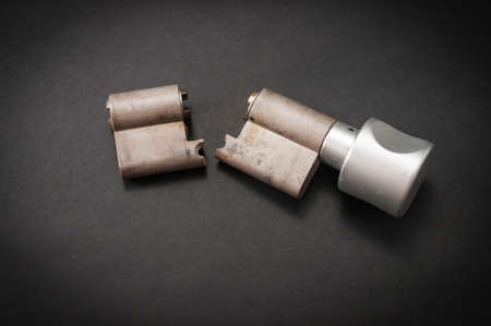 Lock cylinder with knob broken in the middle. Cylinder was pulled during an attempted break-in and was destroyed as a result.