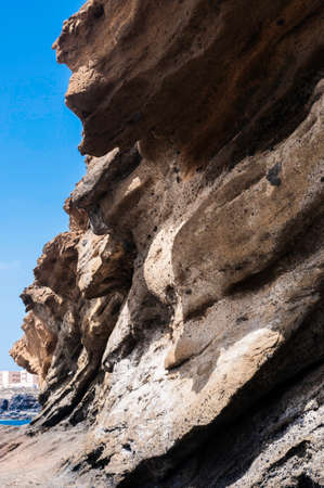 Washed out stone formation on a coast Фото со стока