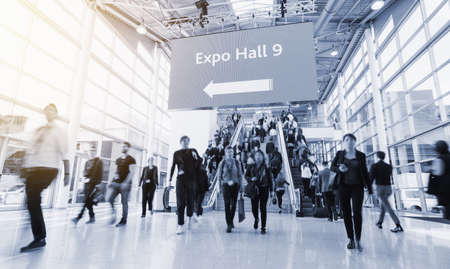 blurred people at a trade fair hall 스톡 콘텐츠