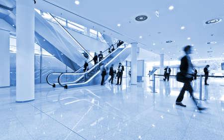 blurred people at a trade fair hall 免版税图像