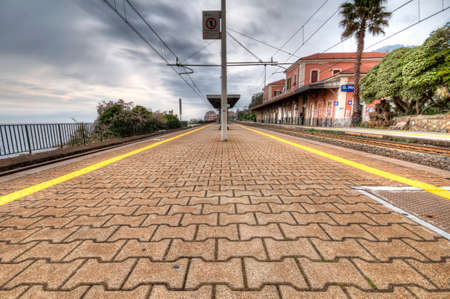 hardships: Train station of Genova Nervi sea. HDR photo in before a thunderstorm Stock Photo