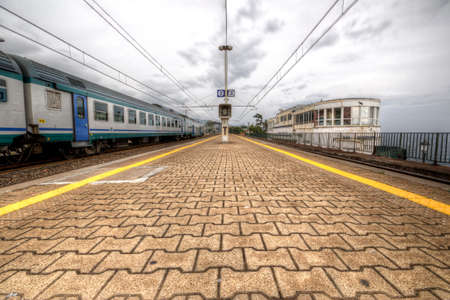 hardships: Train station of Genova Nervi sea. HDR photo in before a thunderstorm2