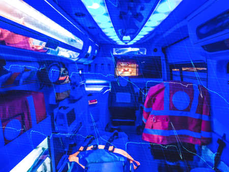 fibrillation: Double exposure of an ambulance  and ECG by night. Out of focus. Stock Photo