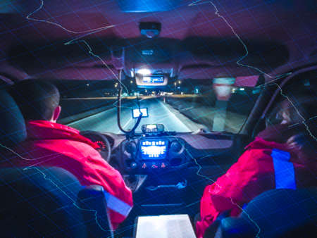 Double exposure of a driving compartment of an ambulance and ECG. Out of focus.