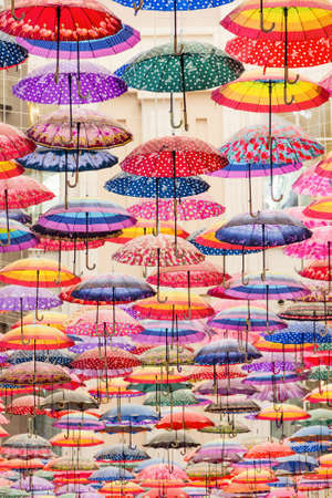 Colorful umbrellas on the ceiling of the largest mall in the world Dubai Mall UAE. Stock fotó