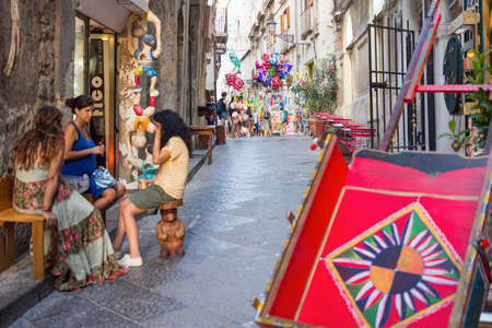 characteristic: August 24, 2017 - Ortigia (Siracusa) - Italy: view of a characteristic alley of Ortigia (Sicily), Sicilian cart in the foreground. Editorial