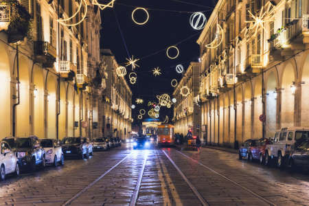 27 December 2017, Torino (TO) Italy: View of a main street of Turin. Christmas artist lights lit above the road.
