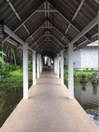 corridor cross the pond in garden Stock Photo - 21569405