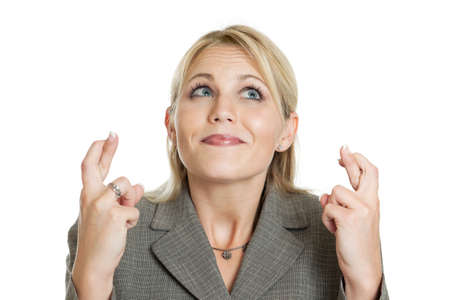 Business woman crossing her fingers Stock Photo - 11246293