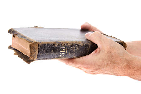 worn: Hands holding a Bible Stock Photo