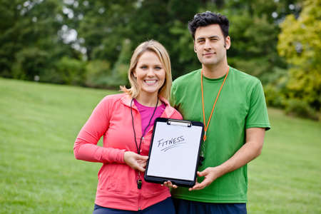 whistles: Personal trainers with fitness sign