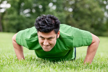 Fit man doing push ups photo