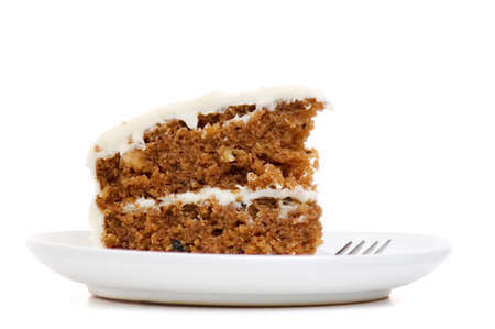 Slice of carrot cake isolated on white Stok Fotoğraf