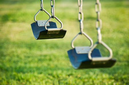 Swings at a playground Stock fotó