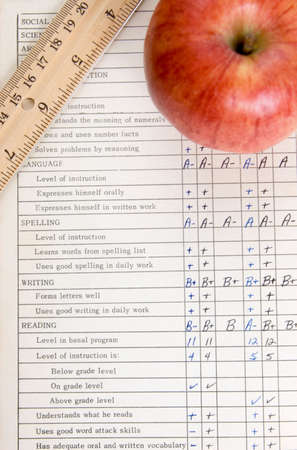 grades: Apple and ruler on vintage report card