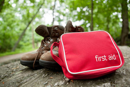 First aid kit and hiking boots photo