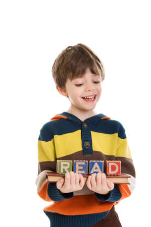 Child with blocks spelling READ photo