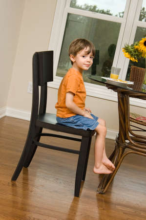 dining table and chairs: Child at the breakfast table