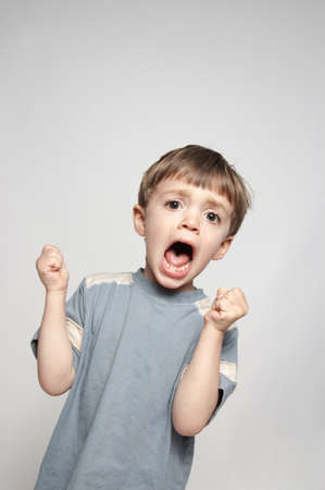 yell: Little boy screaming Stock Photo