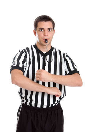 Teen basketball referee giving sign for traveling photo
