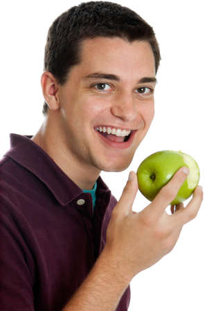Teen boy eating an apple photo
