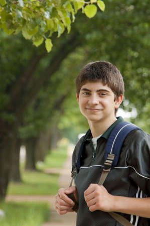 Preteen boy student with backpack photo