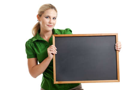 Woman holding blank chalkboard isolated on white Stock Photo - 12892865