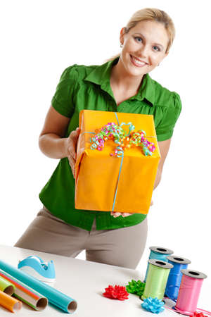 Woman wrapping gift photo