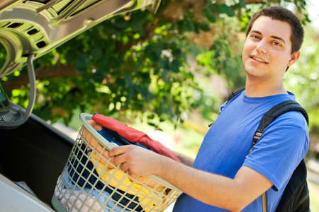 College student putting laundry in the trunk Stock Photo