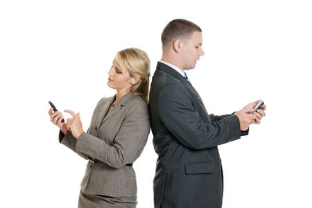 Businessman and woman on their smartphones Stock Photo - 12897293