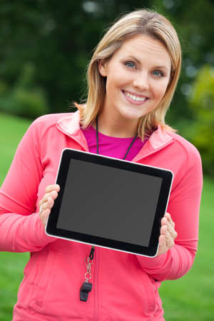 blank tablet: Fitness coach with tablet PC