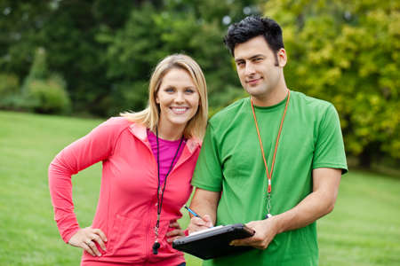 Male and female fitness coaches