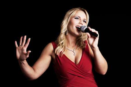 female singer: Beautiful singer with microphone Stock Photo