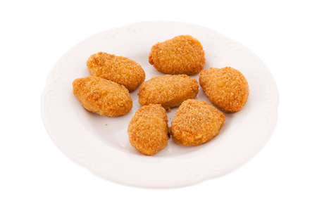 Chicken nuggets on a plate Stock Photo