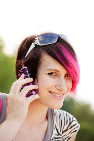 Young punk woman on the cell phone