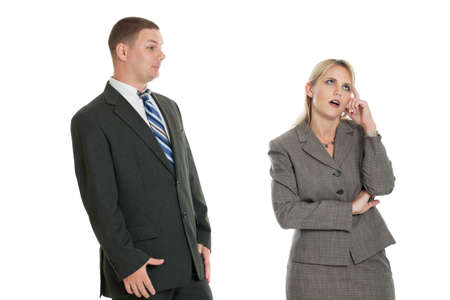 annoying: Business woman tired of hearing business mans excuses isolated on white background