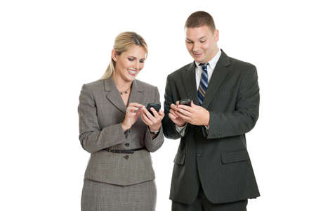 Businessman and woman looking at smartphones isolated on white photo