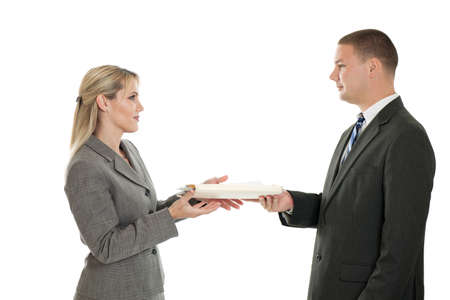 Businessman handing a folder to a businesswoman isolated on white background