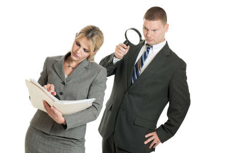 Businessman spying on businesswoman with magnifying glass isolated on white background photo