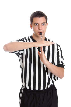 Teenage basketball referee giving sign for technical foul