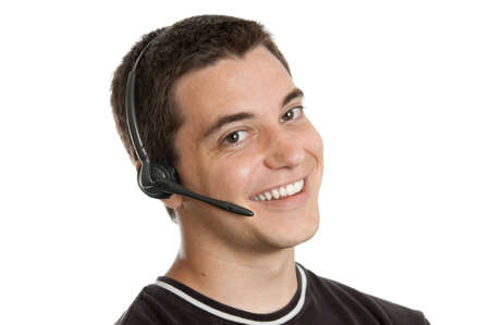 17: Teen boy wearing a headset isolated on white background Stock Photo