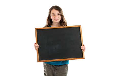 10 years old: School girl holding blank chalkboard isolated on white