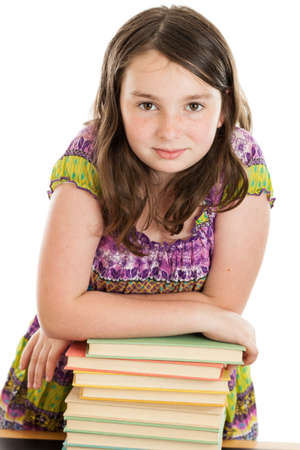 10 years old: Elementary school girl leaning on a stack of books