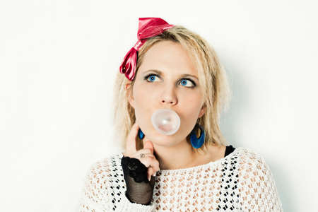 1980s style blond chewing bubble gum portrait