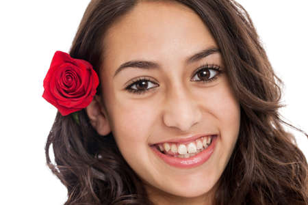 Tween girl with rose in hair portrait isolated on a white background Imagens