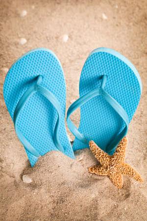 flip flops: Flip flops in the sand
