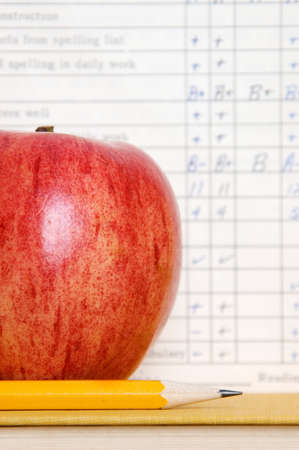 academic achievement: Apple with vintage report card Stock Photo