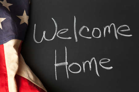 Welcome home sign on a chalkboard Stock Photo