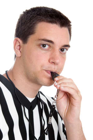 Teen boy referee blowing whistle isolated on white photo
