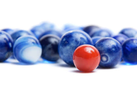 Red vintage marble in a crowd of blue marbles Banco de Imagens - 20477745